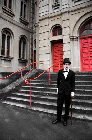 sinister: Vintage Sinister Man Standing In Front Of Steps Of Stone Building