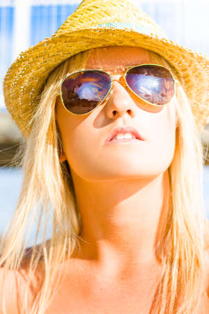 humid: Face Of Fashion With A Beautiful Beach Babe Or Woman Wearing Straw Hat And Hot Sunglasses Staring At The Sun At A Warm Temperate And Humid Beach Location