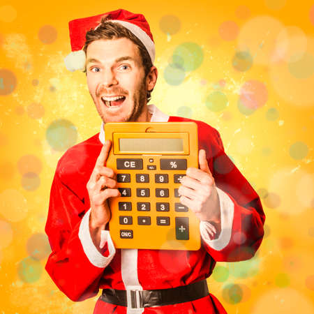 christmas debt: Crazy colourful photo of a santa man expressing happiness with yellow finance calculator. Save at christmas