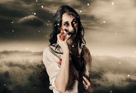 scary girl: Deadly blizzard of falling snow pouring down on a dead female zombie crying tears of pain