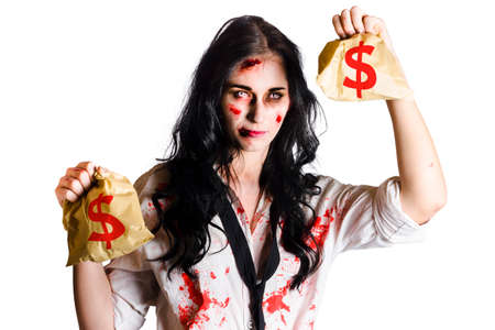 attacked: Bleeding, blood stained young woman holding bags with dollar signs indicating shes been attacked and robbed isolated on white background