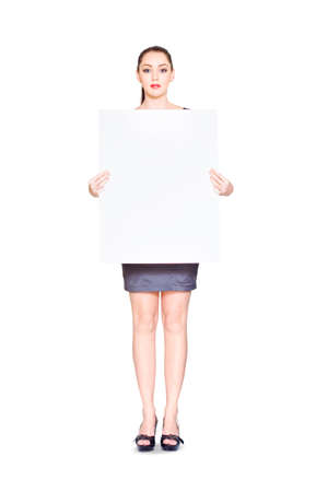 commercialism: Cute Young Marketing Business Person Promoting Business Deals And Discounts On A Blank Board That You Can Write Anything On, Isolated On White Background