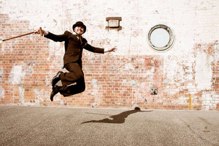 waltzing: A Man In Period Attire Jumping In The Air Shows Happiness Is A Dance Stock Photo