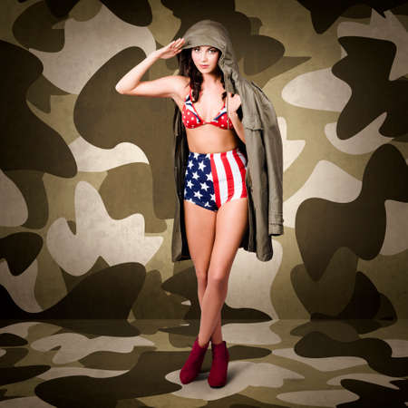 world war two: Retro pinup girl in army uniform standing in world war two camouflage interior with red boots