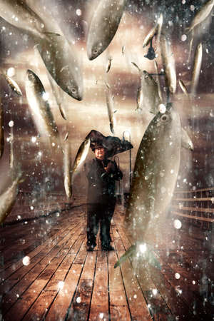 inclement: Inspiring And Imaginative Portrait Of A Senior Man Holding A Broken Umbrella On A Bridge Or Pier While Fish Pour Down From Stormy Skies In A Depiction Of A Miracle