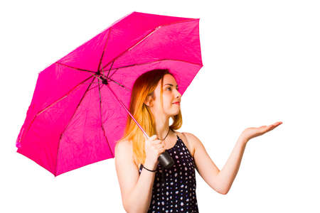 inclement: Sensory image of a woman standing out in the rain feeling handfuls of raindrops when living in the moment Stock Photo
