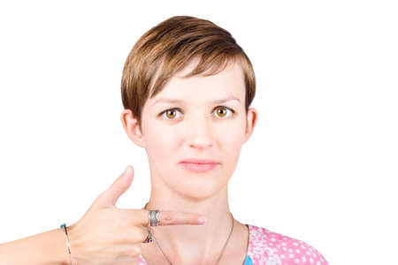 selling points: Gun sales woman pointing to isolated white copyspace when selling products direct Stock Photo