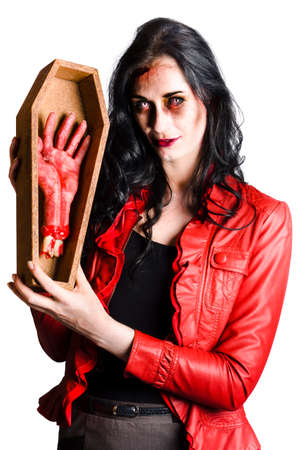 malevolent: Evil zombie woman holding a small coffin with a bloody severed hand
