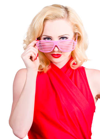 the latest models: Funky summer fashion portrait of an attractive young blond girl in fashionable sunglasses Stock Photo