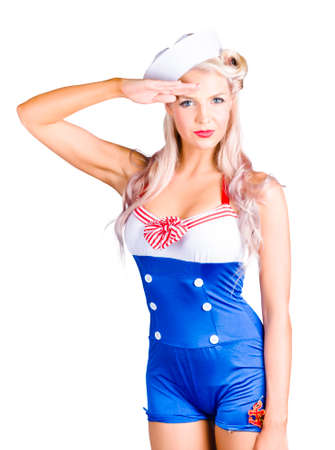 Isolated portrait of a beautiful blond american pin-up girl sailor saluting with a Yes Sir on white background Stock Photo