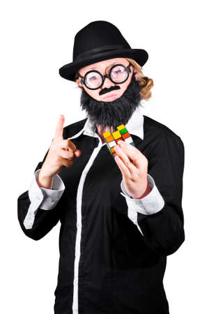 disguised: Pointing Disguised Woman As Man With False Beard And Mustache Holding Cube Puzzle On White Background Stock Photo