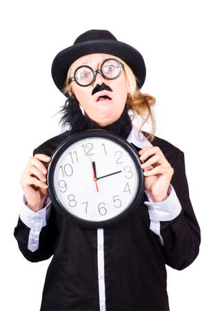 disguised: Woman disguised as man with hat and mustache holding large clock, business time shedule concept on white background.