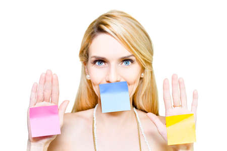 voiceless: Funny isolated studio portrait of a an attractive young blond woman holding 3 colourful blank sticky notes with message copyspace, on white background