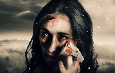 reanimated: Fine art horror photo of a zombie woman crying tears of blood in a cold winter storm when expressing the sadness of loss