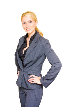 intelligently: Studio Portrait Of A Happy Confident And Smiling Business Woman Standing With Hands To Hips Wearing Corporate Attire In A Successful Businesswoman Concept Stock Photo