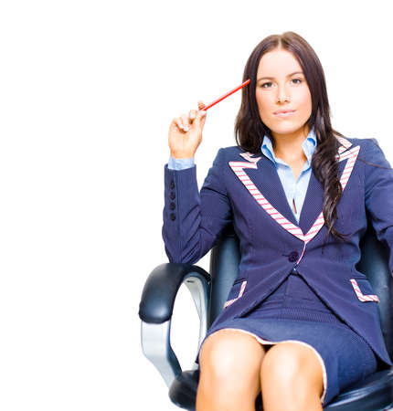 Young Profession Female Business Person Holding Pencil Up To Head While Thinking On A Swivel Chair In A Ideas And Business Development Concept Isolated On White