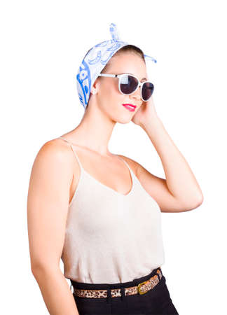 near side: Happy pin up woman with head scarf and sunglasses, white background. Retro fashion style.