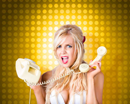 phone cord: Image of a hysterical pinup girl tangled in a fifties phone cord knot. Retro communication tangle Stock Photo