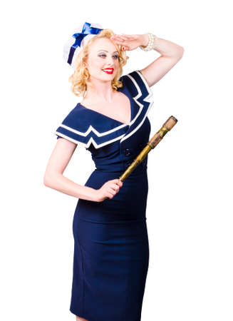 marine ship: Sailor girl pin-up looking out to sea with vintage telescope. Maritime navigation concept Stock Photo