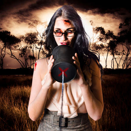 female devil: Concept photograph of a female model in devil makeup making a halloween announcement through a tin can phone. Dark haunted wetland background