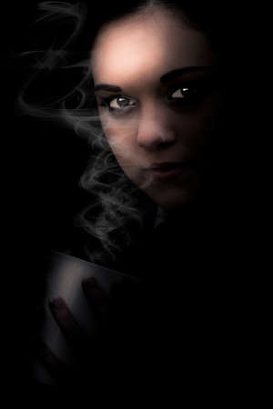 dimly: Face Of A Dark Female Figure Standing In The Dimly Lit Darkness With A Hot Drink In A Dark Side Of Coffee Concept