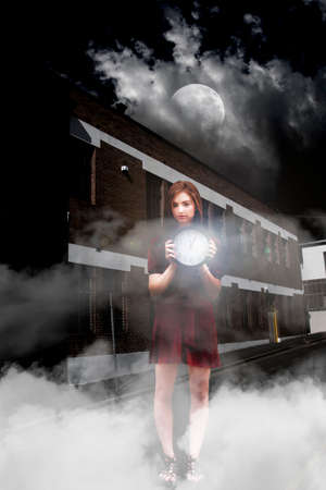 after midnight: Young Woman In A Night Time Setting Outside A Building, Holding A Clock Reading Just After Midnight