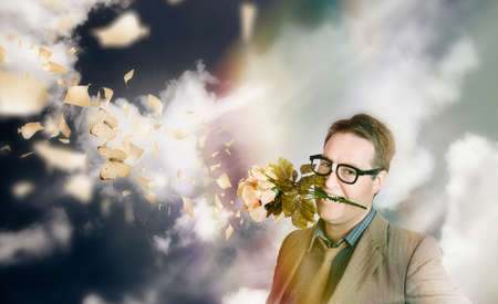 dork: Creative portrait of a love struck man with butterflies and a flower bouquet standing outside in blissful happiness. Dreaming dork with head in the clouds