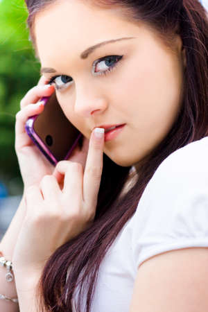clandestine: Mysterious Business Woman Gesturing A Hush For Quiet Silence While Taking A Private And Personal Phone Call In A Confidential Secret Womens Business Concept