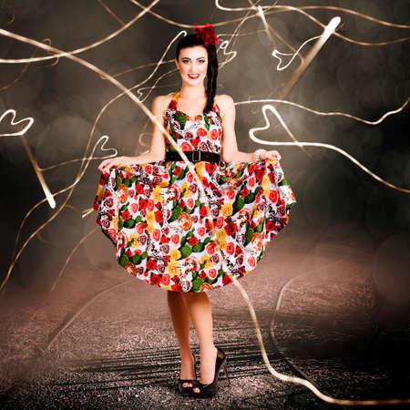 donna innamorata: Creative fashion portrait of a woman dancing in colorful floral dress outdoor. Retro love Archivio Fotografico