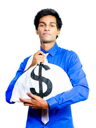tightly: A young Asian busness man hugs a large money bag full of dollars tightly to his chest conceptual of making good money through prudence, hardwork and astute investments