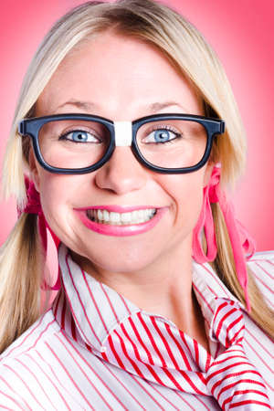 delighted: Closeup portrait of a happy female office worker wearing dorky glasses with shoelace hair ties