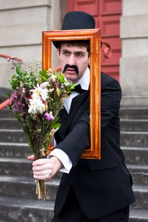 heartwarming: A Vintage Gent Bestows Flowers Through A Wooden Picture Frame With A Revelation Of Romance For The Most Heartwarming Presents Are Gifts From The Imagination