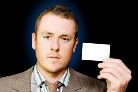 sales rep: Door to door salesman holding up a business card to identify himself and the company he represents as he goes from house to house cold calling