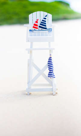 life guard: Caution Unsupervised Beach Image With An Empty Unattended Life Guard Chair On Beach In An Unsupervised Surf Rescue Conceptual Stock Photo
