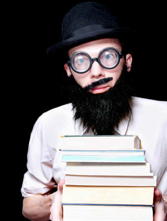 depiction: Funny Looking University Lecturer Holding A Stack Of Library Textbooks In A Humorous Depiction Of Higher Eduction On Black Background Stock Photo