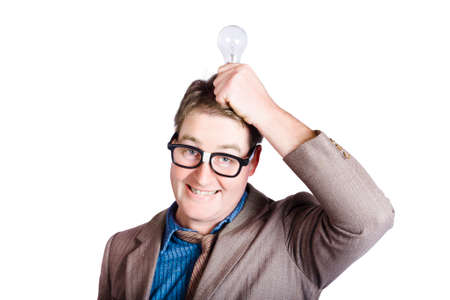 dweeb: Inspired business man smirking with dorky grin when holding light-bulb to head. Mind power Stock Photo