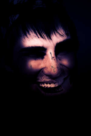 hellish: Dark Creepy And Spooky Undead Or Zombie Pirate Head Smiling With A Diseased Face In A Fearful Hellish Portrait Representing Fear Mystery And Nightmare