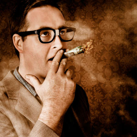 burning: Close vintage portrait of a businessman standing in luxury office suite smoking 100 dollar note. Success in wealth and riches