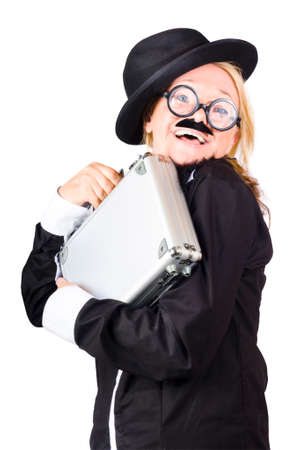 socially: Inept businesswoman wearing black bowler hat, black wide rimmed glasses, fake mustache and carrying gray briefcase isolated on white background Stock Photo