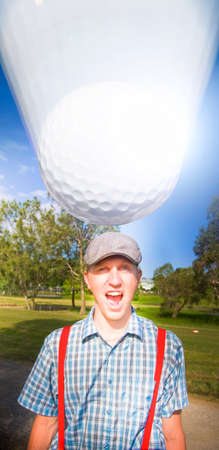 fateful: Golf Ball Moves A Fast Pace Straight At A Screaming Sports Man Standing On A Golfing Green In A Impending Fateful Collation That Will Result In A Golf Injury Stock Photo