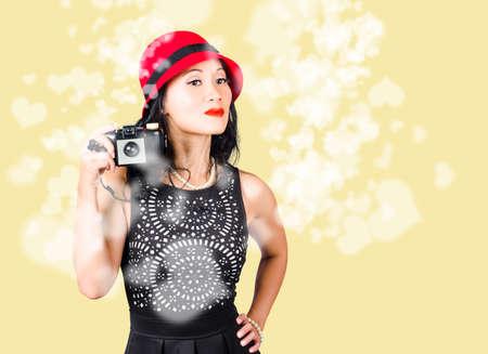 visualise: Female photographer taking photos with retro film camera Stock Photo