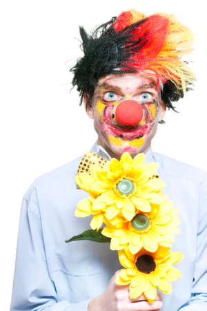 struck: Isolated Love Struck Clown Holding Sunflowers During A Funny Summer Romance On White Background