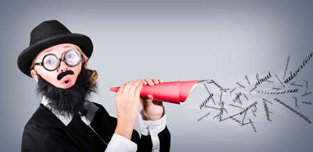 advertise: Megaphone man making loud business noise with hand held speaker on grey background. Advertise