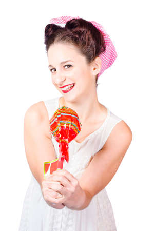 saleslady: Sweet lolly shop lady offering over lollipop with red wrapper on white background. Confectionary service