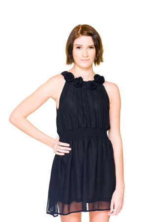 hesitating: On White Picture Of A Unsure Hesitant And Shy Young Brunette Woman Trying On Black Formal Evening Outfit In A Pre Formal Nerves And Tension Concept Stock Photo