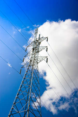 powerline: A High Voltage Powerline Stands Energetically Against An Electric Blue Skyline