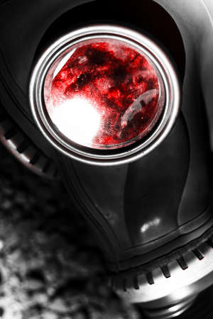 world war 2: Close Up On The Eyepiece On A Vintage World War 2 Military Gas Mask With Blood Splattered Inside In A Blood Of War Conceptual