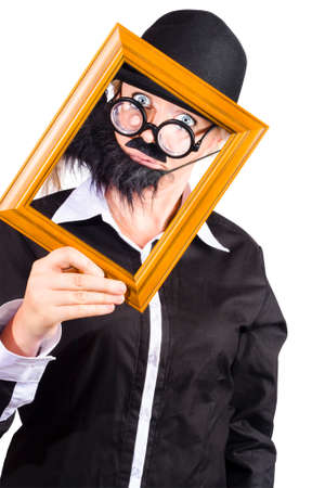 looking through frame: Funny woman disguised as man with beard looking through wooden frame, profile picture concept