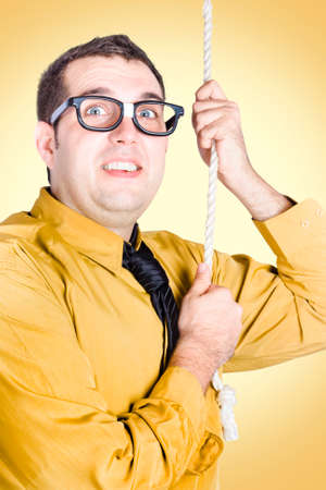fervour: Anxious employee climbing corporate rope with promotion of responsibilities and raise. Yellow background