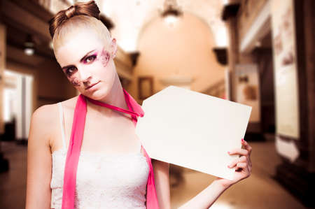 notecard: Retail Marketing And Sales Shopping Concept With A Woman Doll Holding Up A Price Tag Sign With Copyspace Inside A Shop Or Store Stock Photo